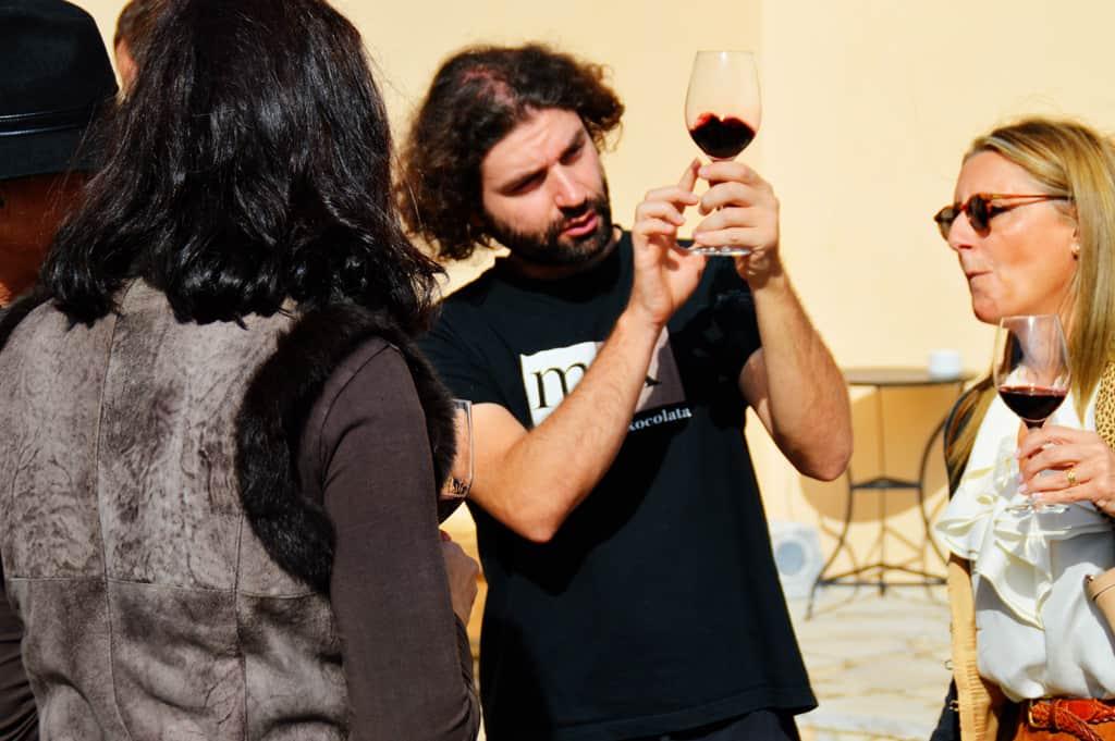 Nick Aivatizidis examining his red wine